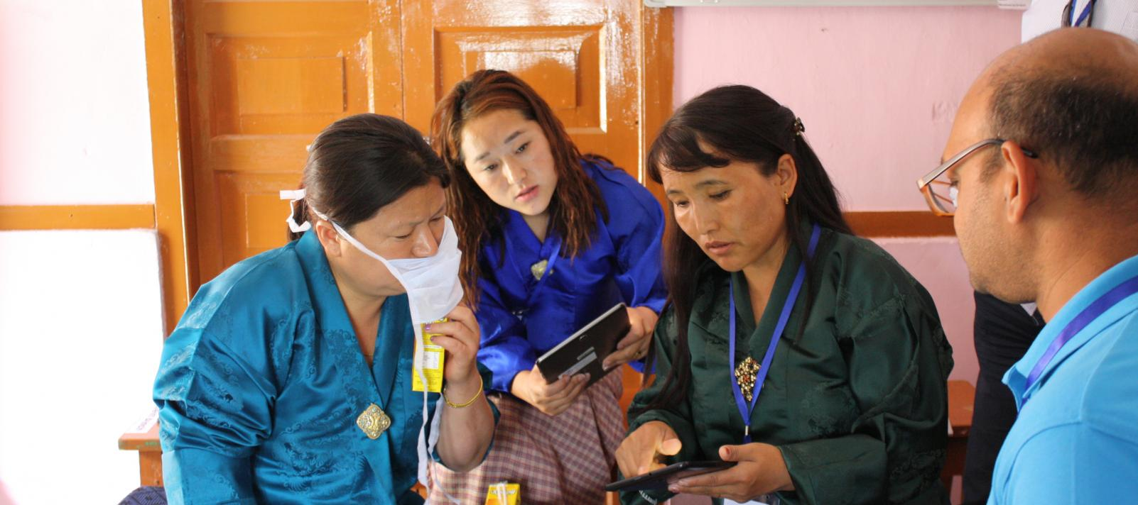Photograph of 3 women taking part in the design research process in Bhutan